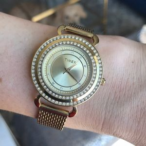 Gold TIMEX watch with stones